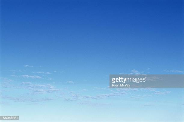 Clear sky with scattered clouds