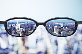 Clear vision concept with eyeglasses and night megapolis city background