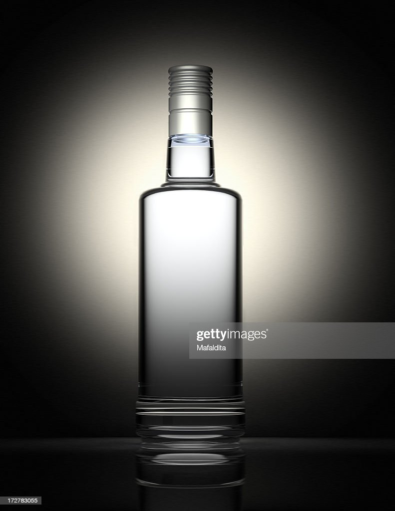 Clear vodka bottle isolated on black and gray background