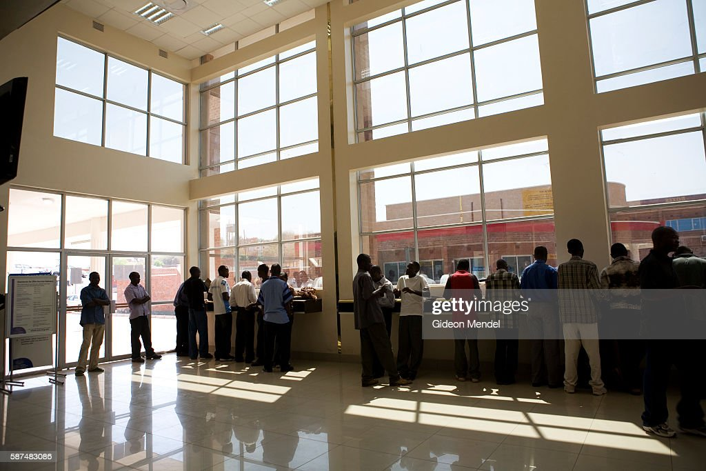 Clearing agents do their paperwork and wait for documents in the impressive new customs building in Chirundu on the border of Zambia and Zimbabwe...
