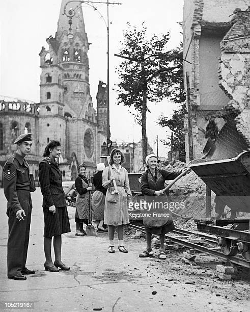 Clearing Out The Rubble From The Unter Den Linden In Berlin In 194546 On The Left A Young Woman And An English Soldier Behind Them The Church Today...