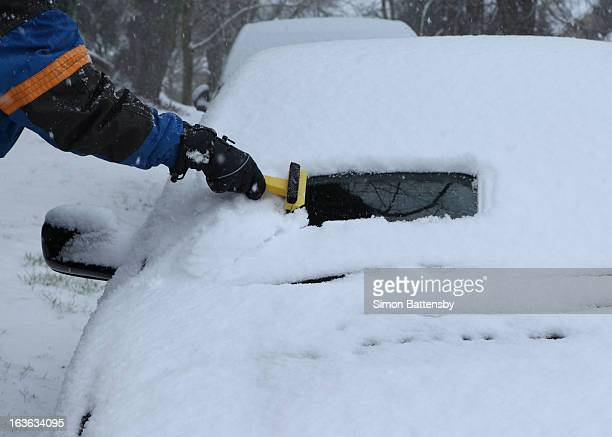 clearing snow from windscreen