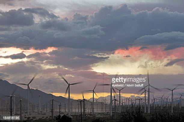 clearing storm with windmills. desert hot springs,
