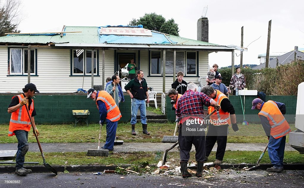 Clearup work beginsat the front of a property on July 6 2007 in the seaside town of Oakura south west of New Plymouth New Zealand A state of...