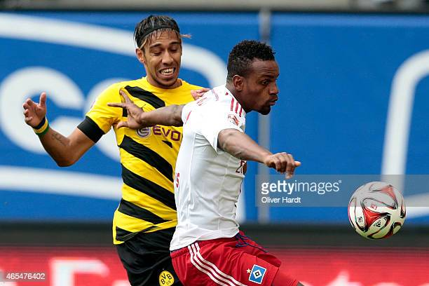 Cleber Reis of Hamburg and Patrick Emerick Aubameyang of Dortmund compete during the First Bundesliga match between Hamburger SV and Borussia...