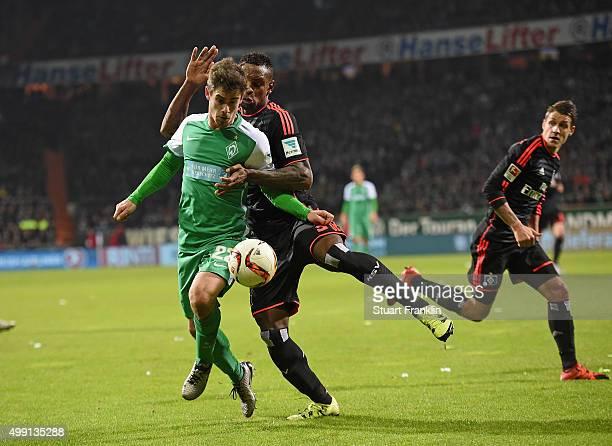 Cleber Reis of Hamburg is challenged by Fin Bartels of Bremen during the Bundesliga match between Werder Bremen and Hamburger SV at Weserstadion on...