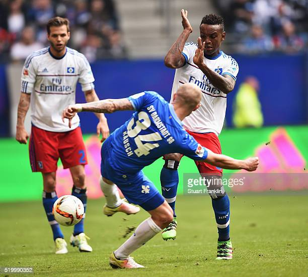 Cleber Reis of Hamburg is challenged by Konstantin Rausch of Darmstadt during the Bundesliga match between Hamburger SV and SV Darmstadt 98 at...