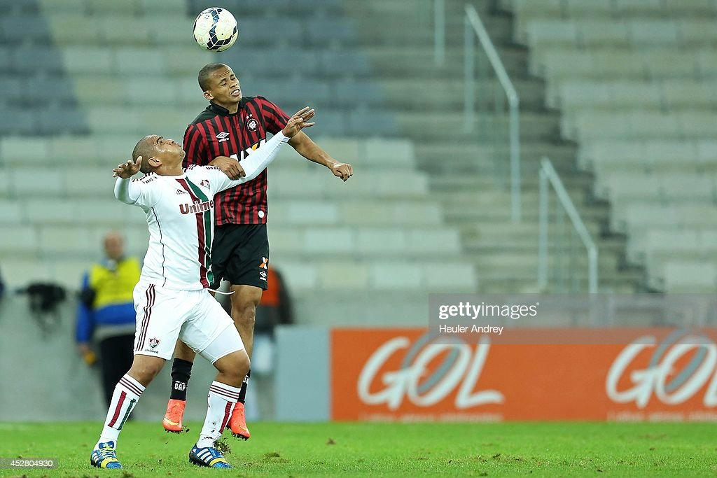Cleberson of Atletico-PR competes for the ball with Valter of Fluminense during the match between Atletico-PR and Fluminense for the Brazilian Series A 2014 at Arena da Baixada on July 27, 2014 in Curitiba, Brazil.