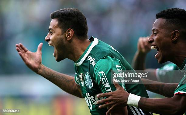 Cleiton Xavier of Palmeiras celebrates scoring the first goal with Tche Tche during the match between Palmeiras and Corinthians for the Brazilian...
