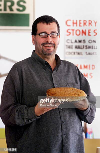 Clem Silva holds his famous clam pie at Clem Ursie's Restaurant and Market He makes his clam pie using a Portuguese recipe