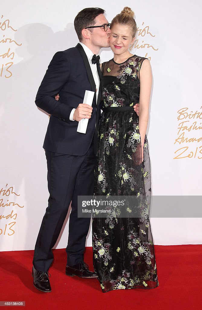Clemence Poesy and Erdem Moralioglu poses in the winners room at the British Fashion Awards 2013 at London Coliseum on December 2, 2013 in London, England.