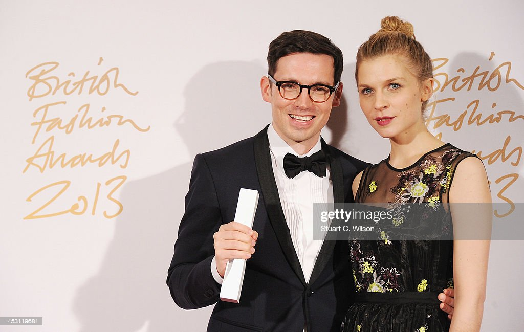 Clemence Poesy and Erdem Moralioglu with the Red Carpet Designer of the Year Award poses in the winners room at the British Fashion Awards 2013 at London Coliseum on December 2, 2013 in London, England.