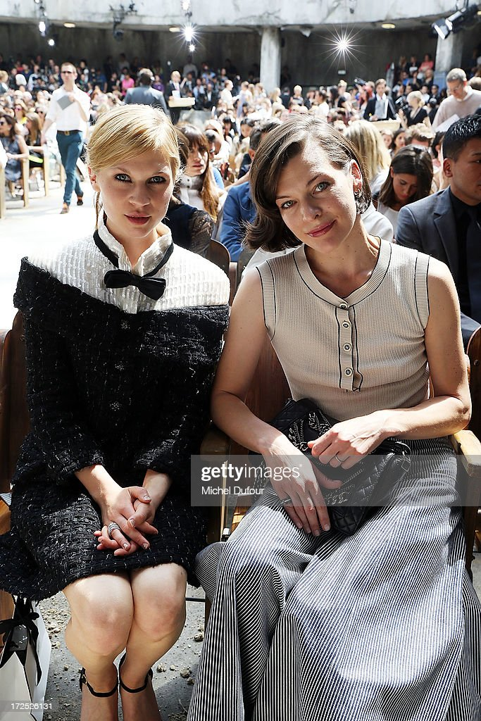 Clemence Poesy and Milla Jovovich attend the Chanel show as part of Paris Fashion Week Haute-Couture Fall/Winter 2013-2014 at Grand Palais on July 2, 2013 in Paris, France.