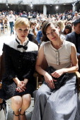 Clemence Poesy and Milla Jovovich attend the Chanel show as part of Paris Fashion Week HauteCouture Fall/Winter 20132014 at Grand Palais on July 2...