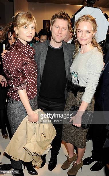 Clemence Poesy Burberry Creative director Christopher Bailey and Kate Bosworth pose backstage following the Burberry Autumn Winter 2012 Womenswear...