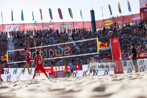 Clemens Doppler and Alexander Horst of Austria competes against Piotr Kantor and Bartosz Losiak of Poland during Day 9 of the FIVB Beach Volleyball...