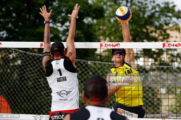 Clemens Doppler of Austria and Janis Smedins of Latvia duel at the net during a game between Latvia and Austria on day 2 of the Moscow 3 Star at...