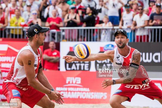 Clemens Doppler of Austria receives the ball during the gold medal match against Andre Loyola Stein and Evandro Goncalves Oliveira Junior of Brazil...