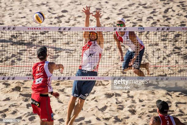 Clemens Doppler of Austria spikes the ball during the quarter final match against Bartosz Losiak and Piotr Kantor of Poland at FIVB Beach Volleyball...