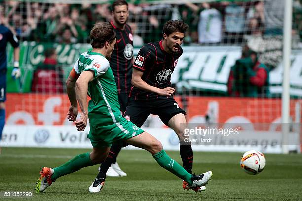 Clemens Fritz of Bremen and Aleksandar Ignjovski of Frankfurt compete for the ball during the Bundesliga match SV Werder Bremen and Eintracht...