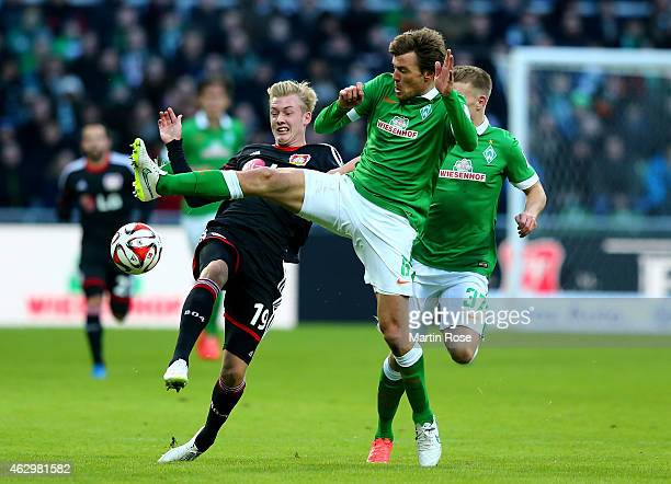 Clemens Fritz of Bremen and Julian Brandt of Leverkusen battle for the ball during the Bundesliga match between SV Werder Bremen and Bayer 04...