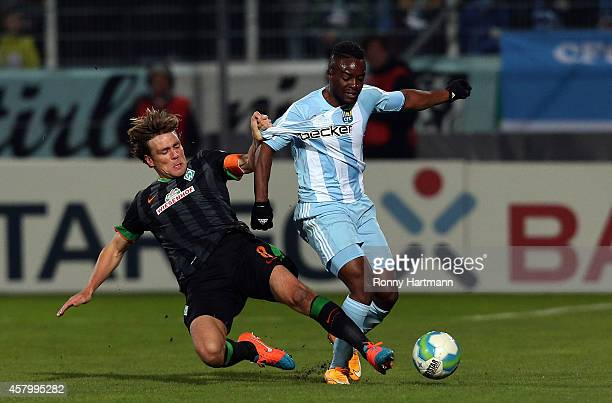Clemens Fritz of Bremen and Reagy Ofosu of Chemnitz battle for the ball during the DFB Cup second round match between Chemnitzer FC and Werder Bremen...