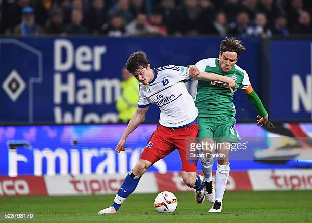 Clemens Fritz of Bremen is challenged by Michael Gregoritsch of Hamburg during the Bundesliga match between Hamburger SV and Werder Bremen at...
