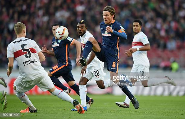 Clemens Fritz of Bremen plays a pass under pressure of Die Serey of Stuttgart during the Bundesliga match between VfB Stuttgart and Werder Bremen at...