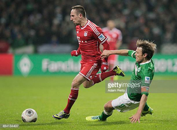 Clemens Fritz of Bremen tackles Franck Ribery of Bayern during the Bundesliga match between Werder Bremen and FC Bayern Muenchen at Weserstadion on...