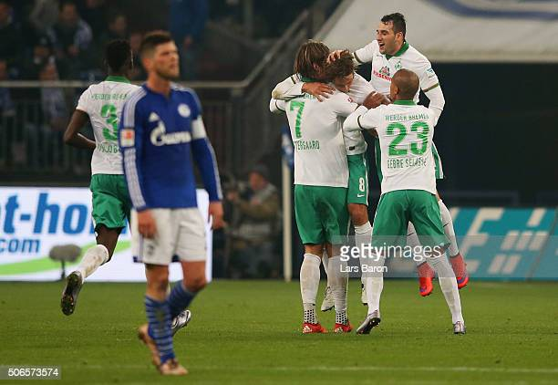 Clemens Fritz of Werder Bremen celebrates with team mates as he scores their first and equalising goal during the Bundesliga match between FC Schalke...