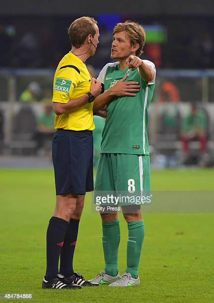 Clemens Fritz of Werder Bremen discusses with referee Sascha Stegemann during the game between Hertha BSC and Werder Bremen on August 21 2015 in...