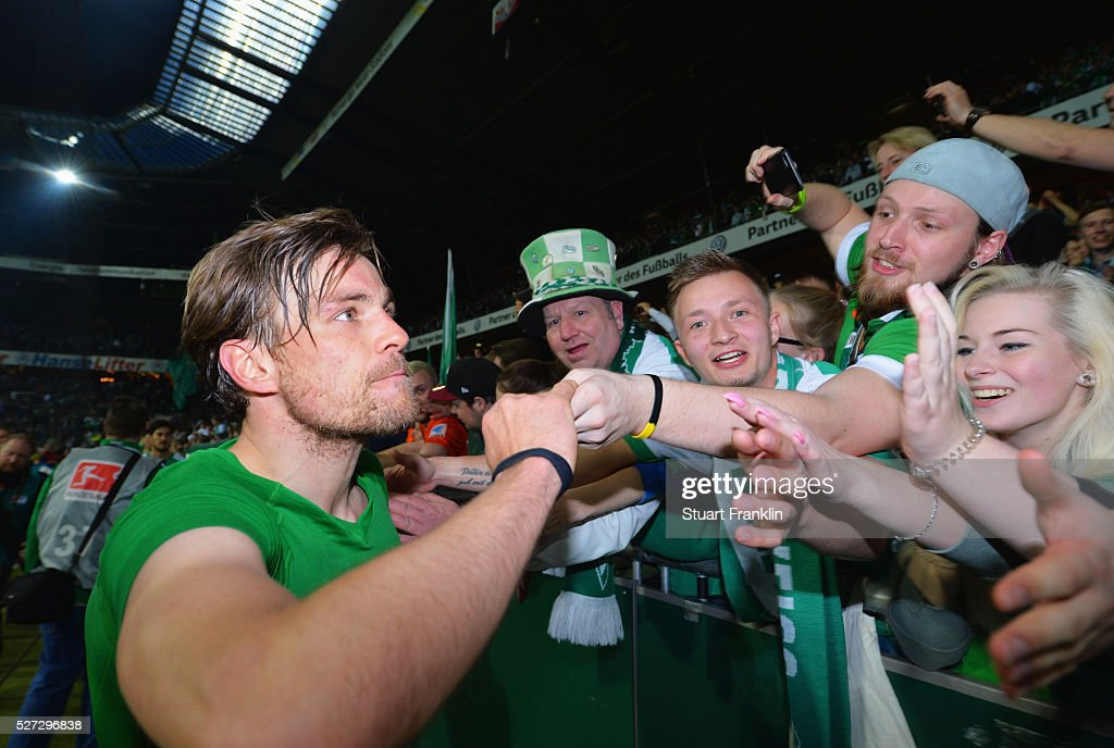 <a gi-track='captionPersonalityLinkClicked' href=/galleries/search?phrase=Clemens+Fritz&family=editorial&specificpeople=645695 ng-click='$event.stopPropagation()'>Clemens Fritz</a> of Werder Bremen shakes hands with fans after a 6:2 victory in the Bundesliga match between Werder Bremen and VfB Stuttgart at Weserstadion on May 2, 2016 in Bremen, Germany.