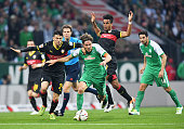 Clemens Fritz of Werder Bremen takes on Federico Barba and Daniel Didavi of Stuttgart during the Bundesliga match between Werder Bremen and VfB...