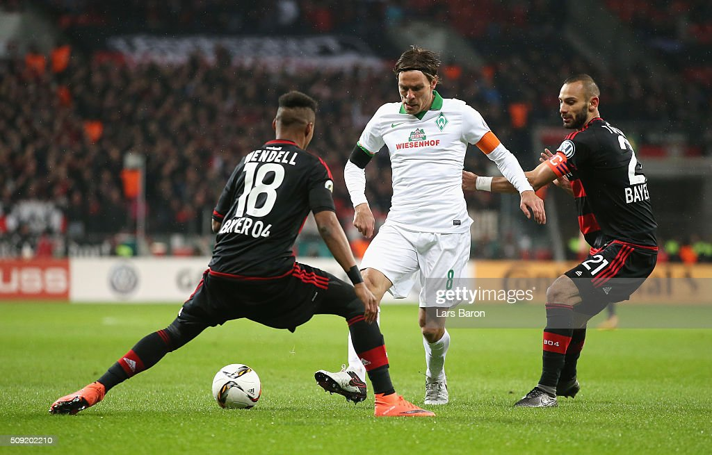 <a gi-track='captionPersonalityLinkClicked' href=/galleries/search?phrase=Clemens+Fritz&family=editorial&specificpeople=645695 ng-click='$event.stopPropagation()'>Clemens Fritz</a> of Werder Bremen takes on Wendell and Omer Toprak of Bayer Leverkusen during the DFB Cup Quarter Final match between Bayer Leverkusen and Werder Bremen at BayArena on February 9, 2016 in Leverkusen, Germany.