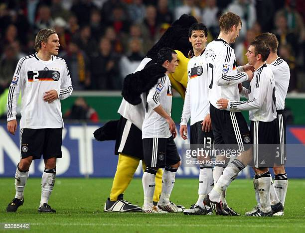 Clemens Fritz Piotr Trochowski Michael Ballack Per Mertesacker and Philipp Lahm of Germany celebrate the 10 victory after the FIFA 2010 World Cup...
