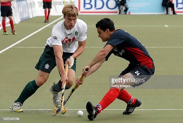 Clemens Oldhafer of Mannheim battles for fhe hockey ball with Jan Fleckhaus of Muehlheim during the men's 3rd/4th place match between Mannheimer HC...
