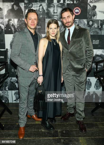 Clemens Schick Aino Laberenz and a guest attending the Studio Babelsberg x Canada Goose Party at Soho House Berlin during the 67th Berlinale...