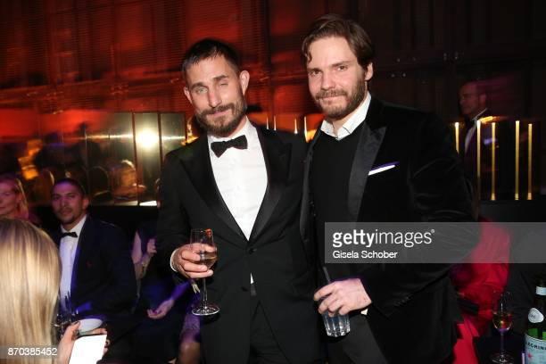 Clemens Schick and Daniel Bruehl during the aftershow party of the 24th Opera Gala benefit to Deutsche AidsStiftung at Deutsche Oper Berlin on...