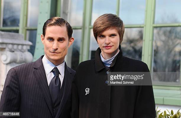 Clemens Schick and Lena Lauzemis pose during the 'Stille Reserven' set visit at Palmenhaus on March 9 2015 in Vienna Austria