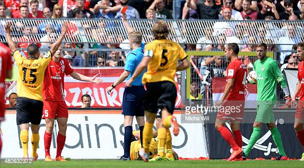 Clemens Schoppenhauer of Wuerzburg is booked with a red card by referee Arne Aarnink during the Third League match between Wuerzburger Kickers and...