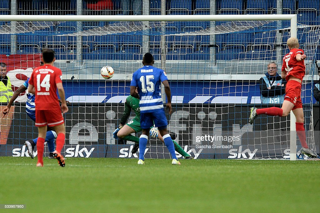 Clemens Schoppenhauer (R) of Wuerzburg scores an own-goal from a header during the 2. Bundesliga playoff leg 2 match between MSV Duisburg and Wuerzburger Kickers at Schauinsland-Reisen-Arena on May 24, 2016 in Duisburg, Germany.