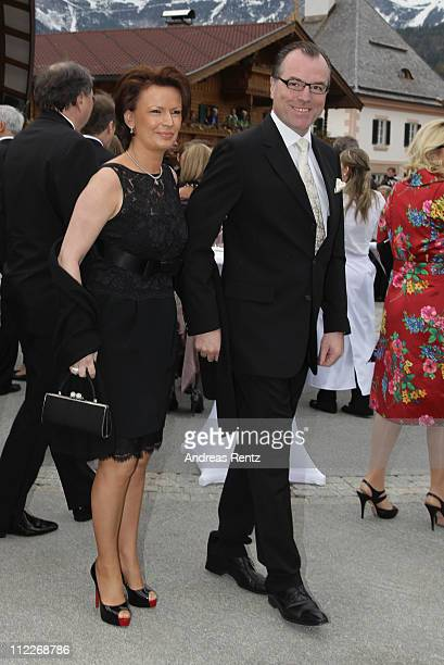 Clemens Toennies and Margit Toennies arrive for the church wedding of Maria HoeflRiesch and Marcus Hoefl at the Pfarrkirche on April 16 2011 in Going...