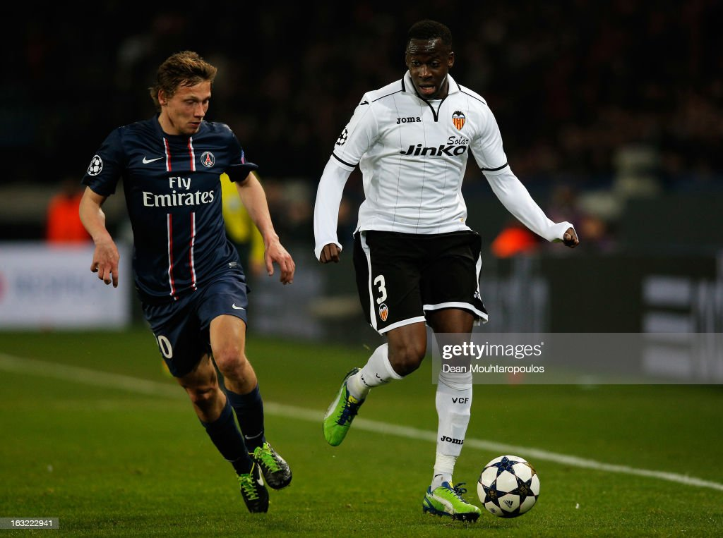 Clement Chantome of PSG and Aly Cissokho of Valencia battle for the ball during the Round of 16 UEFA Champions League match between Paris St Germain and Valencia CF at Parc des Princes on March 6, 2013 in Paris, France.