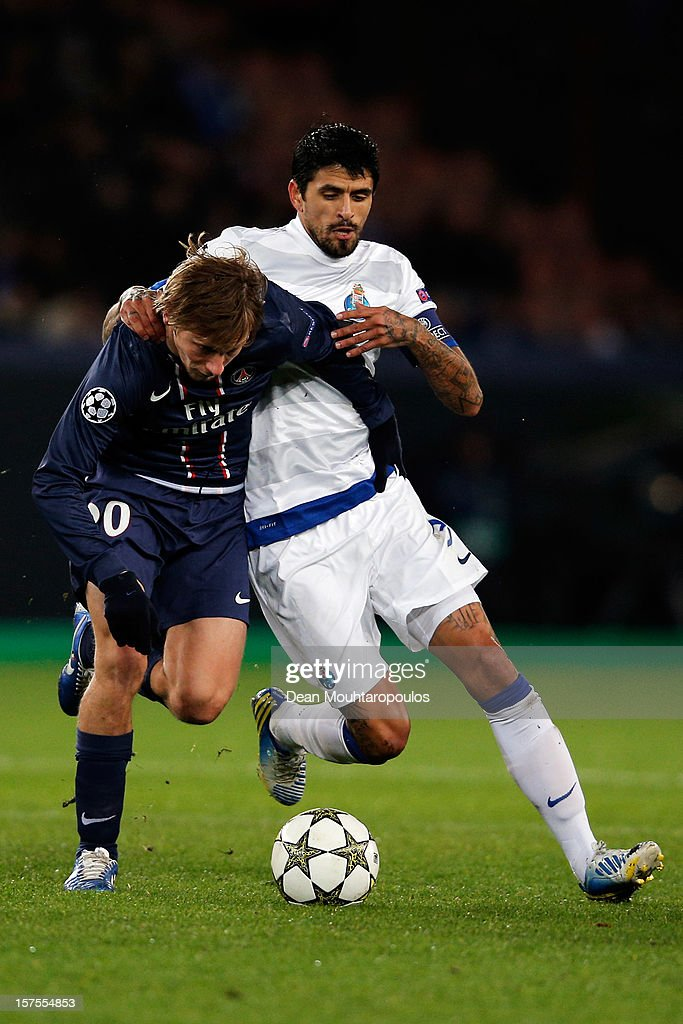 Clement Chantome of PSG and Lucho Gonzalez of Porto battle for the ball during the Group A UEFA Champions League match between Paris Saint-Germain FC and FC Porto at Parc des Princes on December 4, 2012 in Paris, France.