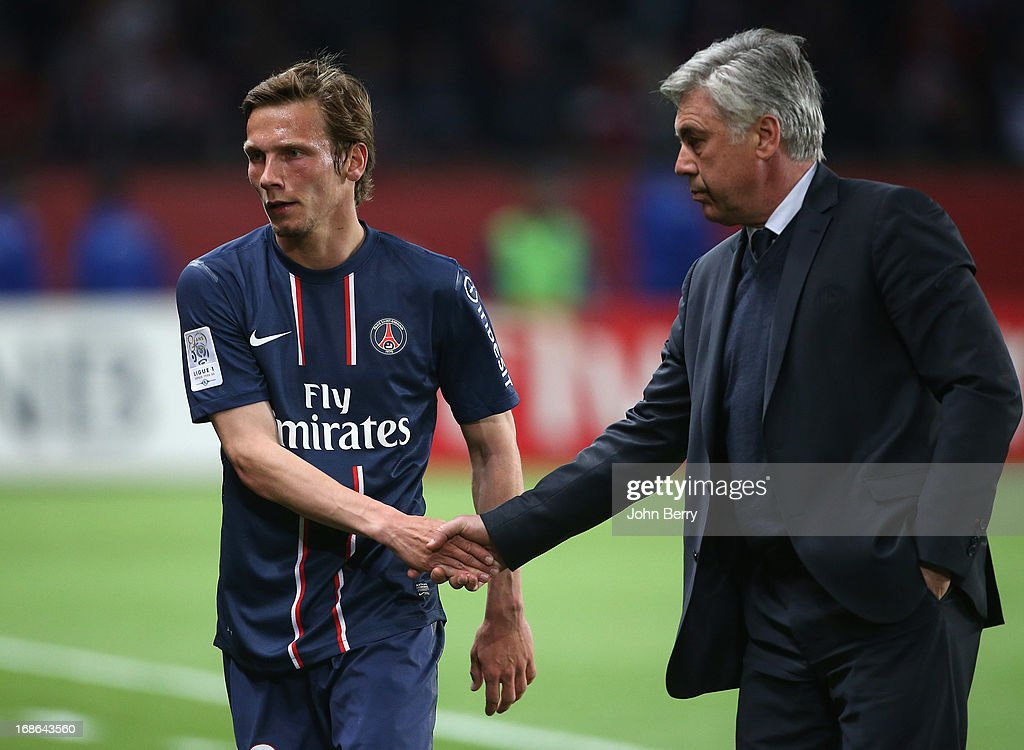 Clement Chantome of PSG checks hands with Carlo Ancelotti, coach of PSG during the Ligue 1 match between Paris Saint-Germain FC and Valenciennes FC at the Parc des Princes stadium on May 5, 2013 in Paris, France.