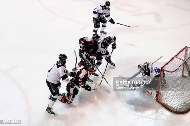 Clement Fouquerel of Gap makes a save under pressure from Lipo Samivirta and Francois Bouchard of Bordeaux during the semi Final of the Ligue Magnus...