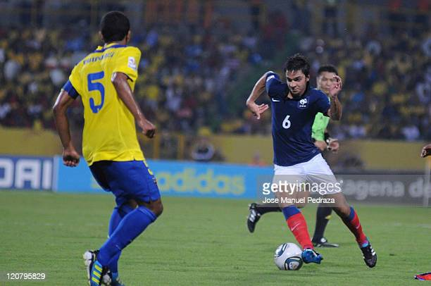 Clement Grenier de France carries the ball in the sight of Dennis Quinones of Ecuador during the final knockout game France vs Ecuador during the...