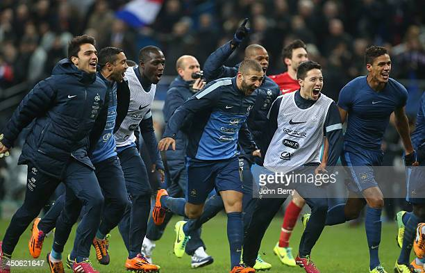 Clement Grenier Karim Benzema Samir Nasri and Raphael Varane of France celebrate the victory at the end of the FIFA 2014 World Cup Qualifier playoff...