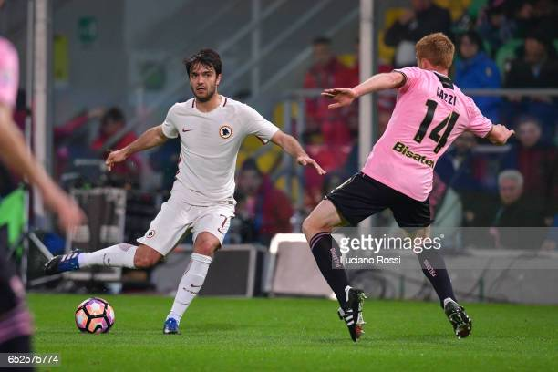 Clement Grenier of AS Roma is challenged by Alessandro Gazzi of US Citta di Palermo during the Serie A match between US Citta di Palermo and AS Roma...