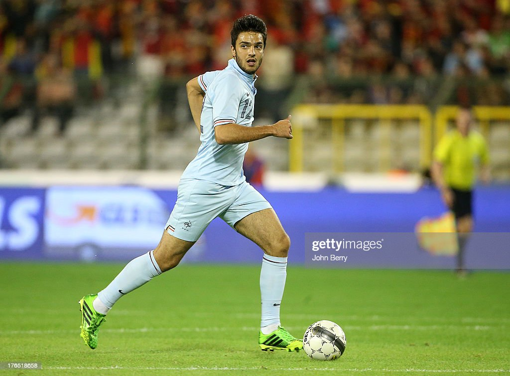 <a gi-track='captionPersonalityLinkClicked' href=/galleries/search?phrase=Clement+Grenier&family=editorial&specificpeople=5774493 ng-click='$event.stopPropagation()'>Clement Grenier</a> of France in action during the international friendly match between Belgium and France at the King Baudouin Stadium on August 14, 2013 in Brussels, Belgium.
